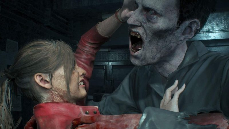 Claire, unarmed, holds back a zombie closing in for the kill.
