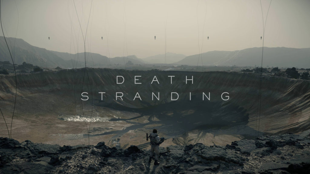Death Stranding: Norman Reedus standing near edge of crater while holding bridge baby