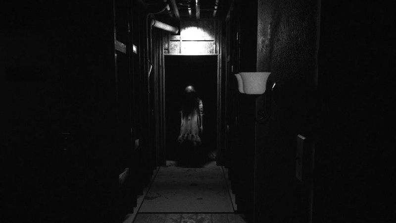 Screenshot of Visage showing a creepy girl at the end of a dark corridor..