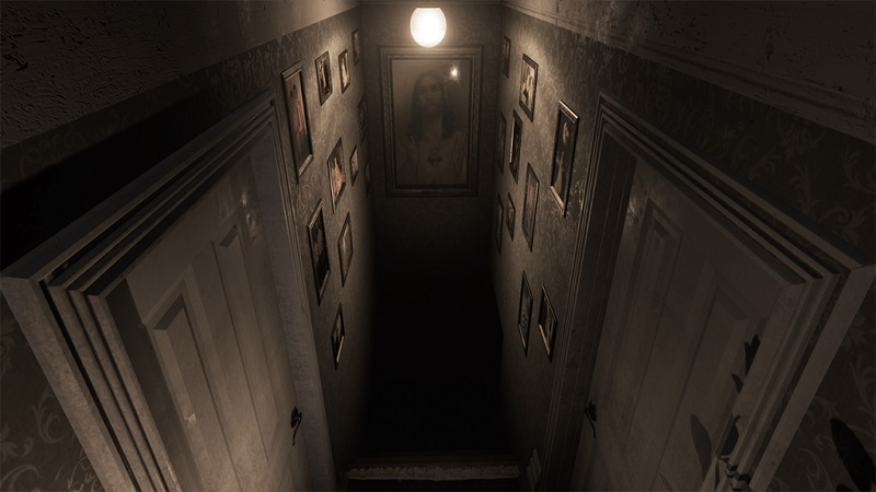 Screenshot from Visage which shows the top of a staircase leading down to a pitch black cellar.