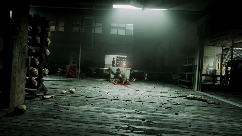 Screenshot from the new Outlast Trials trailer which shows an injured man in the distance.
