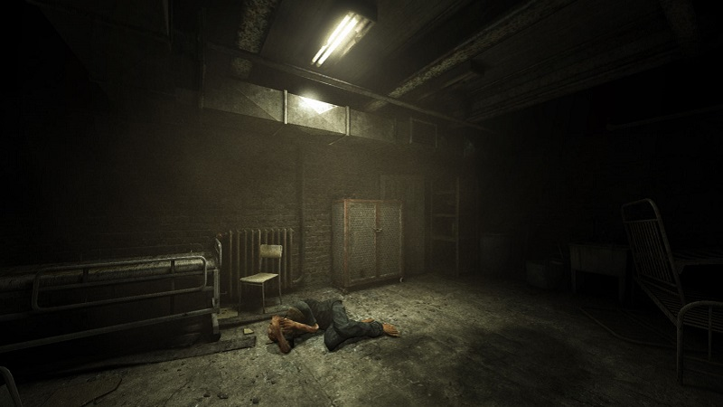 Screenshot from the first Outlast game showing a man in the fetal position on a dirty floor.