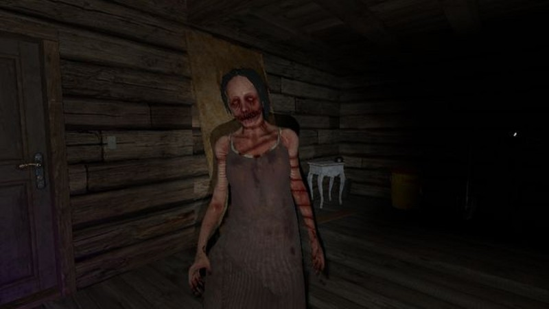 Screenshot from Phasmophobia showing a demonic woman in a dress.